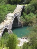 A traditional stone bridge with three arches close to Kipoi village in central Zagori